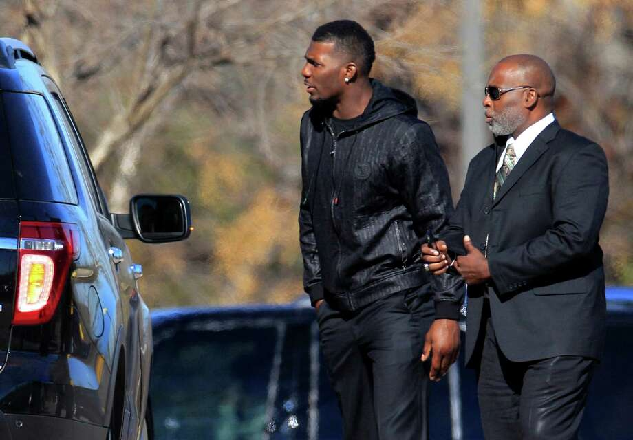 Dallas Cowboys' Dez Bryant, center, arrives with an unknown person at a memorial service for Jerry Brown at Oak Cliff Bible Fellowship, Tuesday, Dec. 11, 2012, in Dallas. Brown, a member of the team's practice squad was killed early Saturday morning when a car driven by teammate Josh Brent was involved in a single vehicle accident. (AP Photo/LM Otero) Photo: LM Otero, Associated Press / AP
