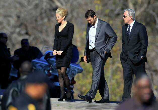 Dallas Cowboys quarterback Tony Romo, center, and his wife Candice, left, along with team public relations director Rich Dalrymple, right, arriveat a memorial service for Jerry Brown at Oak Cliff Bible Fellowship, Tuesday, Dec. 11, 2012, in Dallas. Brown, a member of the team's practice squad was killed early Saturday morning when a car driven by teammate Josh Brent was involved in a single vehicle accident. (AP Photo/LM Otero)at a memorial service for practice squad member Jerry Brown at Oak Cliff Bible Fellowship Tuesday, Dec. 11, 2012, in Dallas. (AP Photo/LM Otero) Photo: LM Otero, Associated Press / AP