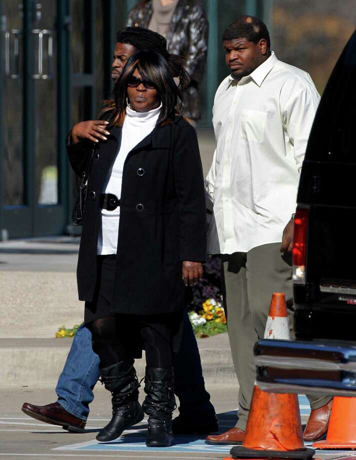 Dallas Cowboys' Josh Brent, right, arrives with unidentified persons at a memorial service for teammate Jerry Brown at Oak Cliff Bible Fellowship education center Tuesday, Dec. 11, 2012, in Dallas. Brown died in a suspected drunken-driving accident on Saturday. Brent was the driver and is charged with intoxication manslaughter. (AP Photo/Tony Gutierrez) Photo: Tony Gutierrez, Associated Press / AP