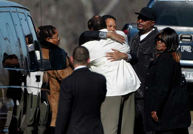 Dallas Cowboys football player Josh Brent, center foreground, receives a hug from an unknown person as he arrives at a memorial service for teammate Jerry Brown at Oak Cliff Bible Fellowship Tuesday, Dec. 11, 2012, in Dallas. Brown died in a suspected drunken-driving accident on Saturday. Brent was the driver and is charged with intoxication manslaughter.(AP Photo/Tony Gutierrez) Photo: Tony Gutierrez, Associated Press / AP