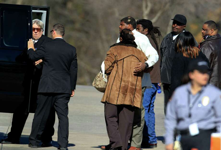 Dallas Cowboys football player Josh Brent, center in light shirt, embraces an unknown person as they arrive for a memorial service for teammate Jerry Brown at Oak Cliff Bible Fellowship Tuesday, Dec. 11, 2012, in Dallas. Brown died in a suspected drunken-driving accident on Saturday. Brent was the driver and is charged with intoxication manslaughter. (AP Photo/LM Otero) Photo: LM Otero, Associated Press / AP