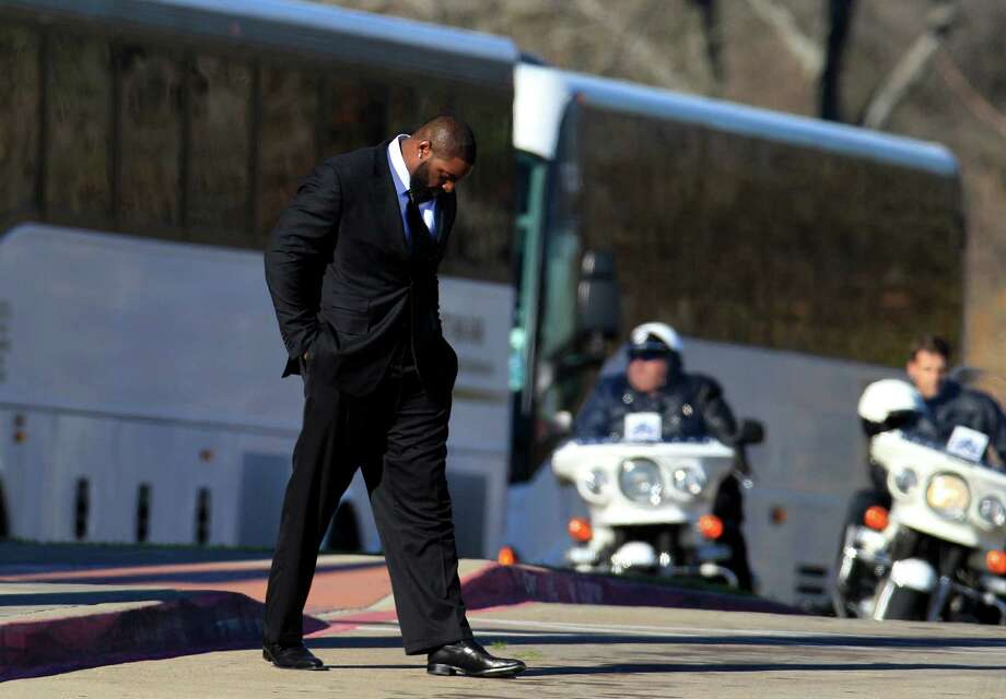 Dallas Cowboys nose tackle Jay Ratliff leaves a memorial service for practice squad member Jerry Brown at Oak Cliff Bible Fellowship Tuesday, Dec. 11, 2012, in Dallas. (AP Photo/LM Otero) Photo: LM Otero, Associated Press / AP