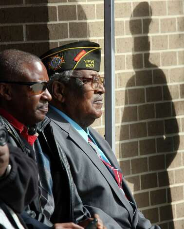 World War II veteran Calvin Curtis, 87, right, sits with his son, Devon, before he is presented with the Congressional Gold Medal during a ceremony at Fort Sam Houston, Tuesday, Dec. 11, 2012. Curtis was a member of the Montford Point Marines, the nation's first black Marines. Photo: Jerry Lara, San Antonio Express-News / © 2012 San Antonio Express-News