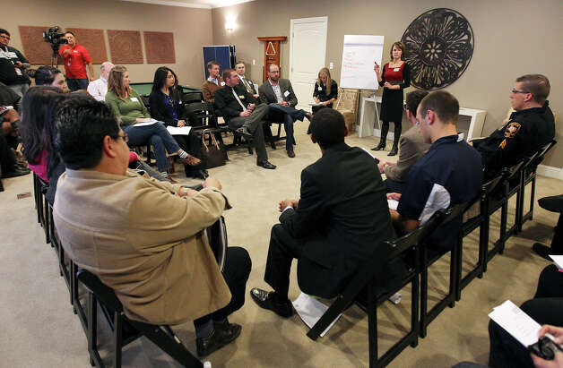 Community leaders including UTSA campus police and a District 8 staffer meet at Aspen Heights - an off-campus student living community - to discuss ideas about how to deal with growth-related problems like crime and traffic in neighborhoods near UTSA on Tuesday, Dec. 11, 2012. Photo: Kin Man Hui, San Antonio Express-News / © 2012 San Antonio Express-News