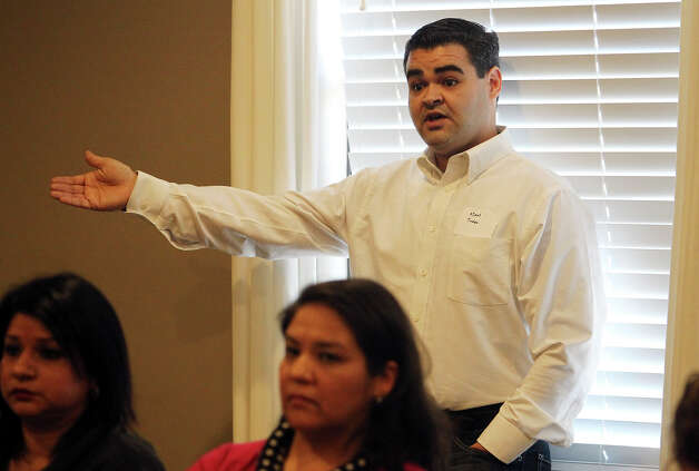 District 8 staffer Adam Trevino addresses the group during a community meeting at Aspen Heights to discuss ideas about how to deal with growth-related problems like crime and traffic in neighborhoods around UTSA on Tuesday, Dec. 11, 2012. Photo: Kin Man Hui, San Antonio Express-News / © 2012 San Antonio Express-News