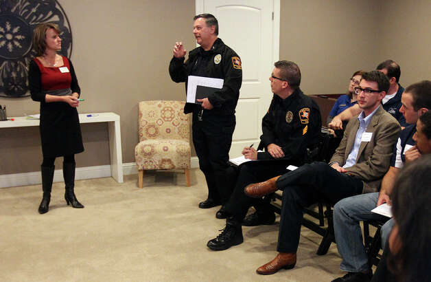 UTSA Assistant Police Chief Daniel Pena speaks at a community meeting at Aspen Heights to discuss ideas about how to deal with growth-related problems like crime and traffic in neighborhoods around UTSA on Tuesday, Dec. 11, 2012. Photo: Kin Man Hui, San Antonio Express-News / © 2012 San Antonio Express-News