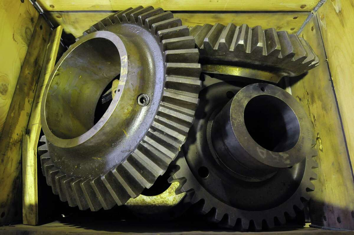 Large gears are seen in a box during an auction of State-owned surplus train parts at the Rotterdam Industrial Park on Tuesday, Dec. 11, 2012 in Rotterdam, NY. (Paul Buckowski / Times Union)