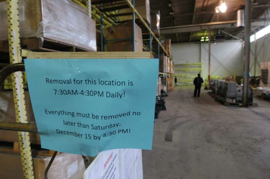 Signs are posted alerting the winning bidders to when items must be picked up by during an auction of State-owned surplus train parts at the Rotterdam Industrial Park on Tuesday, Dec. 11, 2012 in Rotterdam, NY.  (Paul Buckowski / Times Union) Photo: Paul Buckowski