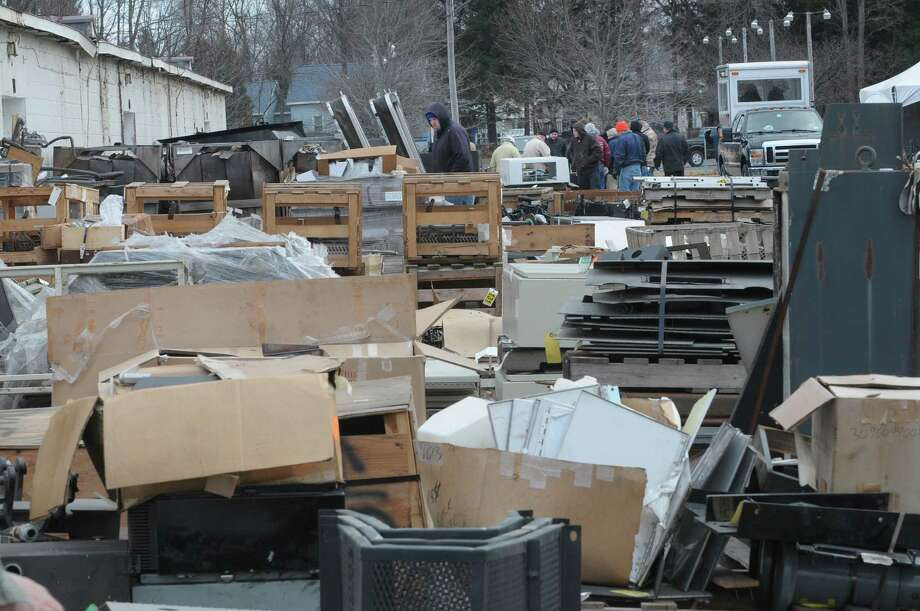 Mounds of train parts were up for bid during an auction of State-owned surplus train parts at the Rotterdam Industrial Park on Tuesday, Dec. 11, 2012 in Rotterdam, NY.  (Paul Buckowski / Times Union) Photo: Paul Buckowski