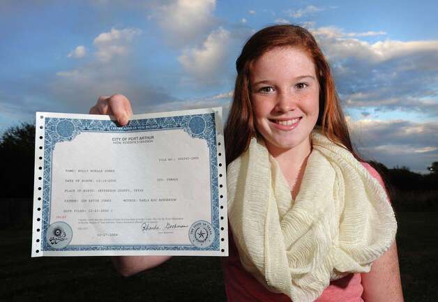 Holly Jones, 11, holds up her birth certificate Tuesday which shows she turns 12 on 12/12/12. Today is the last time that December 12 will occur for 100 years. Photo taken Tuesday, December 11, 2012 Guiseppe Barranco/The Enterprise Photo: Guiseppe Barranco, STAFF PHOTOGRAPHER / The Beaumont Enterprise