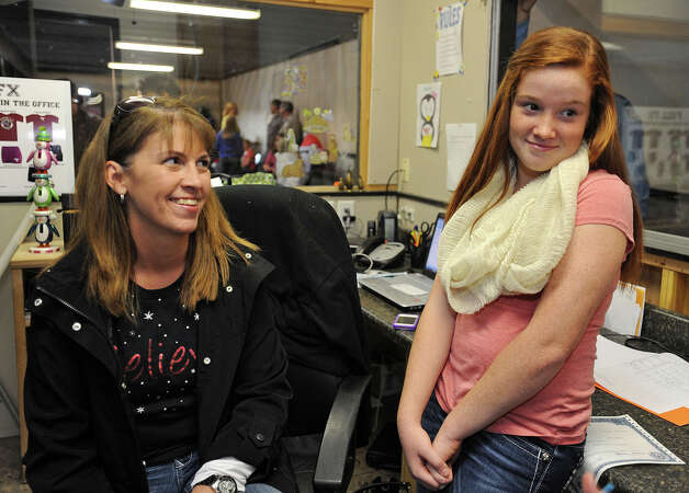 Darla Jones looks at her daughter Holly Jones, 11, on Tuesday. Holly turns 12 years old on December 12, 2012. Today is the last time that December 12 will occur for 100 years. Photo taken Tuesday, December 11, 2012 Guiseppe Barranco/The Enterprise Photo: Guiseppe Barranco, STAFF PHOTOGRAPHER / The Beaumont Enterprise