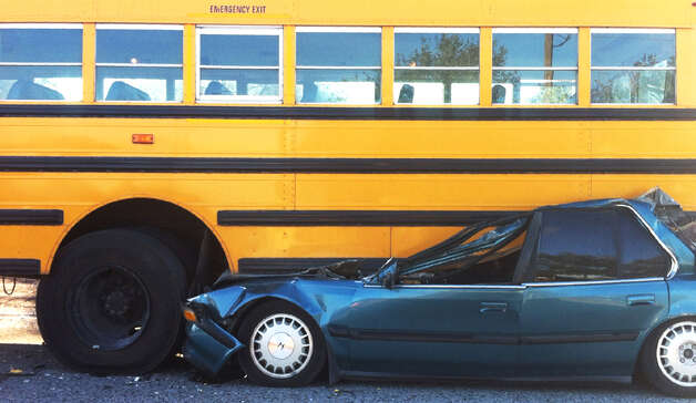 Deputies said the bus had come to stop to pick up three students. Before the students were able to find seats, the car slammed into the back of the bus. | Cody Duty / Houston Chronicle Photo: .