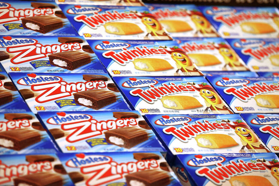 Hostess snacks are offered for sale at a Jewel-Osco grocery store on December 11, 2012 in Chicago, Illinois. The Jewel-Osco grocery store chain purchased the last shipment of 20,000 boxes of Hostess products and put them on sale in their stores throughout the Chicago area today. Hostess Brands Inc. shut down its baking operations and began liquidating assets last month after failing to negotiate a labor contract with Workers with the Bakery, Confectionery, Tobacco Workers and Grain Millers International Union. Photo: Scott Olson, Getty Images / 2012 Getty Images