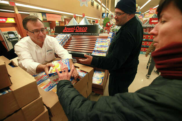 Customers grab Hostess Twinkies from John Kolton before he can replenish the display at a Jewel-Osco grocery store on December 11, 2012 in Chicago, Illinois. The Jewel-Osco grocery store chain purchased the last shipment of 20,000 boxes of Hostess products and put them on sale in their stores throughout the Chicago area today. Hostess Brands Inc. shut down its baking operations and began liquidating assets last month after failing to negotiate a labor contract with Workers with the Bakery, Confectionery, Tobacco Workers and Grain Millers International Union. Photo: Scott Olson, Getty Images / 2012 Getty Images