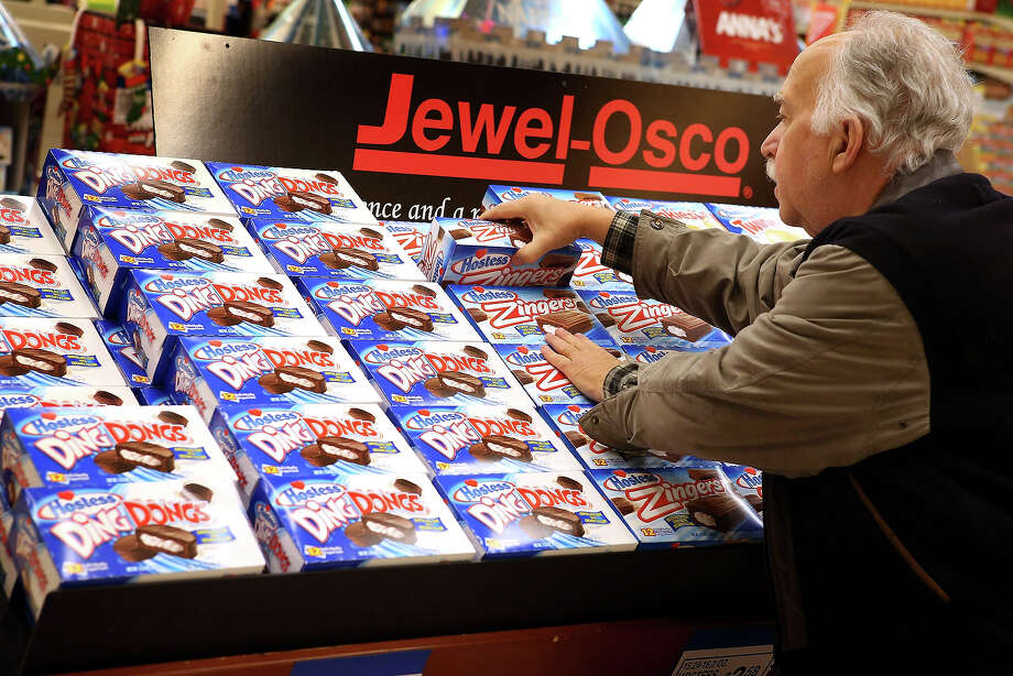 Phil Colin buys Hostess snacks at a Jewel-Osco grocery store on December 11, 2012 in Chicago, Illinois. The Jewel-Osco grocery store chain purchased the last shipment of 20,000 boxes of Hostess products and put them on sale in their stores throughout the Chicago area today. Hostess Brands Inc. shut down its baking operations and began liquidating assets last month after failing to negotiate a labor contract with Workers with the Bakery, Confectionery, Tobacco Workers and Grain Millers International Union. Photo: Scott Olson, Getty Images / 2012 Getty Images