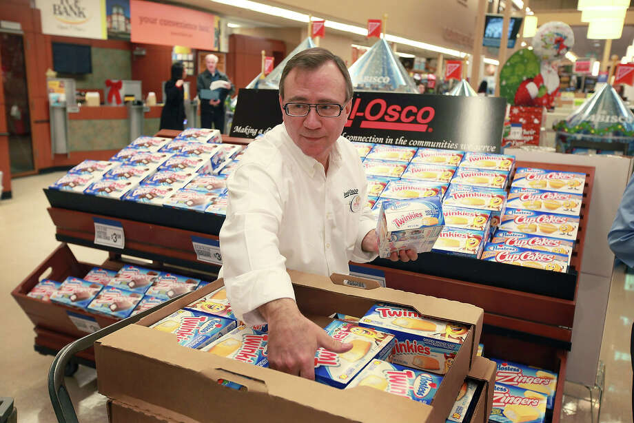 John Kolton stocks a display of Hostess snacks at a Jewel-Osco grocery store on December 11, 2012 in Chicago, Illinois. The Jewel-Osco grocery store chain purchased the last shipment of 20,000 boxes of Hostess products and put them on sale in their stores throughout the Chicago area today. Hostess Brands Inc. shut down its baking operations and began liquidating assets last month after failing to negotiate a labor contract with Workers with the Bakery, Confectionery, Tobacco Workers and Grain Millers International Union. Photo: Scott Olson, Getty Images / 2012 Getty Images