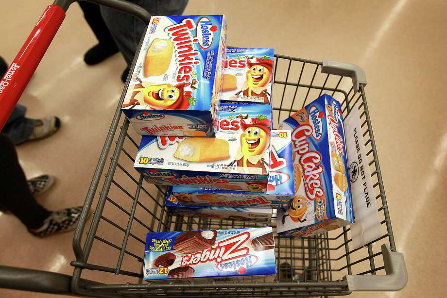 A customer heads to the checkout with a shopping cart loaded with Hostess snacks at a Jewel-Osco grocery store on December 11, 2012 in Chicago, Illinois. The Jewel-Osco grocery store chain purchased the last shipment of 20,000 boxes of Hostess products and put them on sale in their stores throughout the Chicago area today. Hostess Brands Inc. shut down its baking operations and began liquidating assets last month after failing to negotiate a labor contract with Workers with the Bakery, Confectionery, Tobacco Workers and Grain Millers International Union. Photo: Scott Olson, Getty Images / 2012 Getty Images