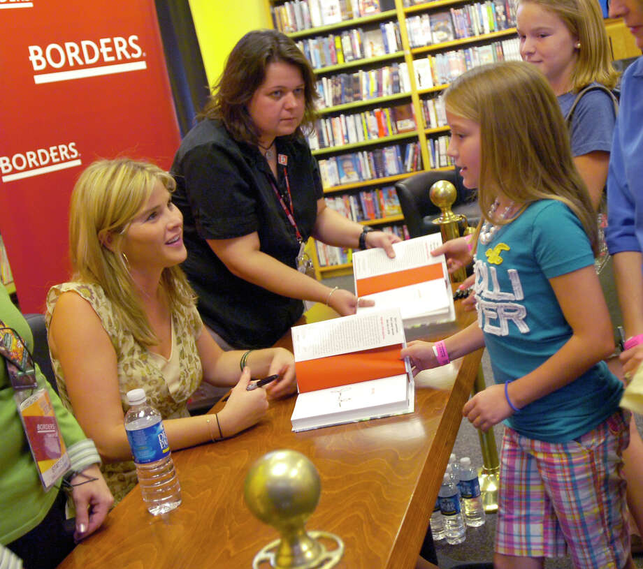Jenna Bush, left, smiles after signing her book for 11-year old Catie Moyer, of Annapolis, Md., Saturday, Sept. 29, 2007, in Annapolis, Md. Also pictured, center, is Dalia Goldgor and Samantha Auer, back right. Photo: Gail Burton, AP / AP