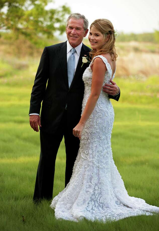 President George W. Bush and his daughter Jenna Bush pose for a photographer Saturday, May 10, 2008, prior to her wedding to Henry Hager at the Bush family's Prairie Chapel Ranch in Crawford, Texas. Photo: Shealah Craighead, AP / The White House