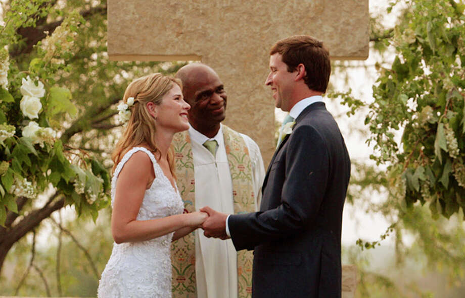 Jenna Bush, daughter of President George W. Bush and first lady Laura Bush, exchanges wedding vows with Henry Hager in an outdoor ceremony at the Bush family's Prairie Chapel Ranch near Crawford, Texas, Saturday, May 10, 2008. Rev. Kirbyjohn Caldwell, center, performs the ceremony. Photo: Shealah Craighead, AP / The White House