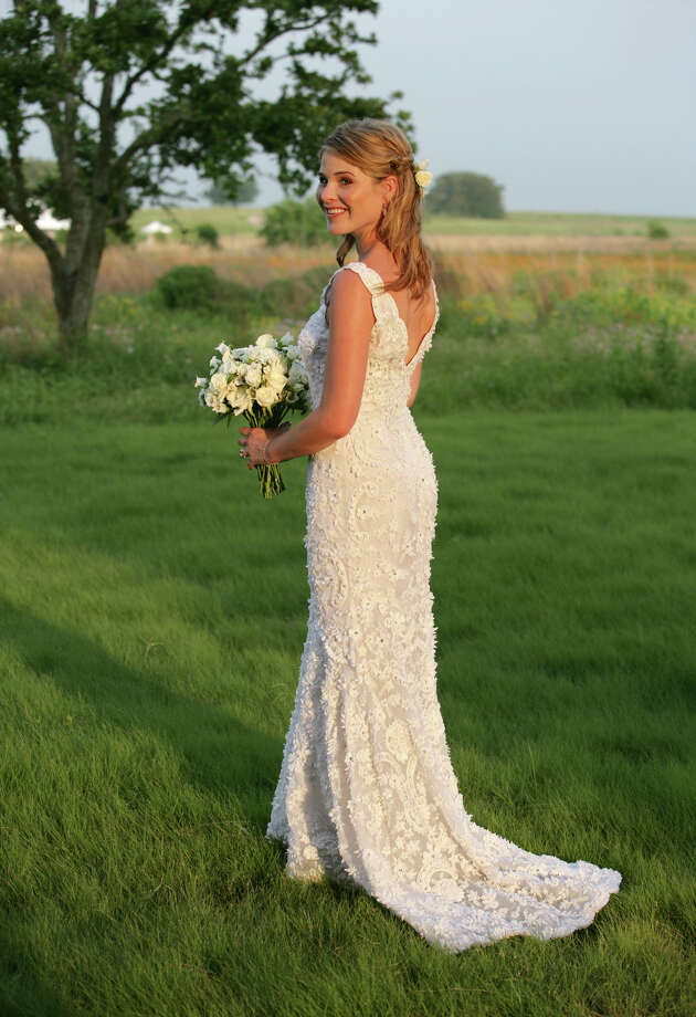 "Jenna Bush, 26, daughter of President George W. Bush and first lady Laura Bush, poses for photos prior to her marriage to Henry Hager at an outdoor ceremony on the Bush family's Prairie Chapel Ranch near Crawford, Texas, Saturday, May 10, 2008. Her wedding gown is by Oscar de la Renta, a top New York designer and favorite of the first lady's. It's made of organza, a sheer fabric, with embroidery and matte beading. Jenna has described the dress as ""simple and elegant."" Photo: Shealah Craighead, AP / The White House"