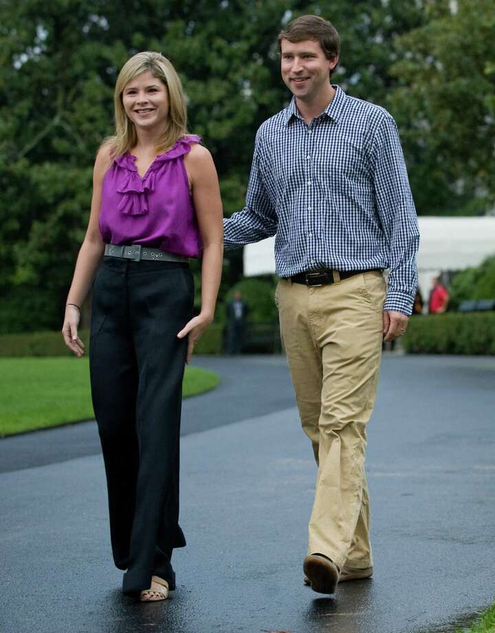 Jenna Bush Hager, daughter of US President George W. Bush, and her husband, Henry Hager, walk down the driveway of the White House to participate in a commemorative tree planting on the South Lawn in Washington, DC, September 27, 2008. AFP PHOTO / Saul LOEB Photo: SAUL LOEB, AFP/Getty Images / 2008 AFP