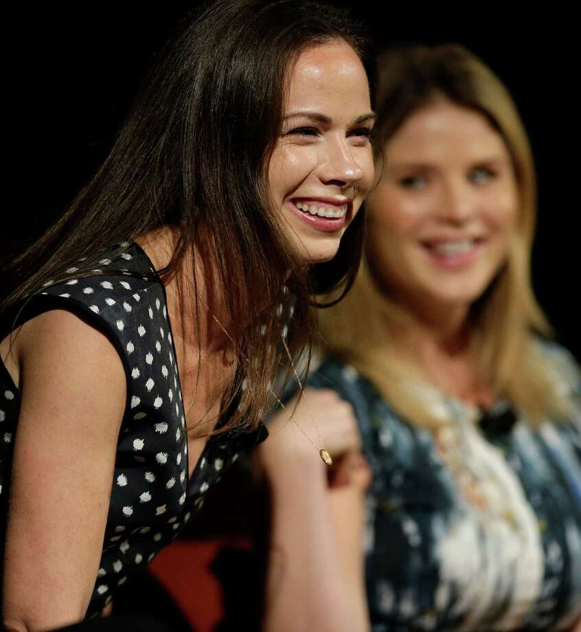 Barbara Pierce Bush, left, laughs with her sister Jenna Bush Hager, right,as they take part in the Enduring Legacies of America's First Ladies conference Thursday, Nov. 15, 2012, in Austin, Texas. The children of three presidents discussed life in the White House as part of a conference on first ladies at the Lyndon B. Johnson Presidential Library. (AP Photo/David J. Phillip) Photo: David J. Phillip, Associated Press / AP