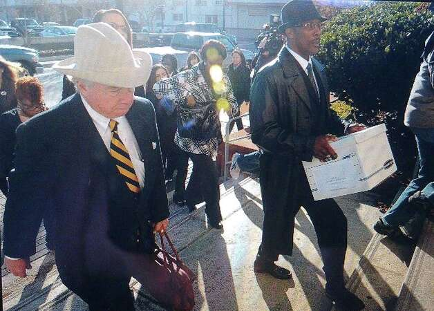 Calvin Walker, right, arrives at the Jack Brooks Federal Courthouse with his attorney, Dick Deguerin.  Guiseppe Barranco/The Enterprise
