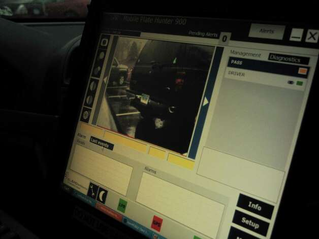 The monitor of the License Plate Reader (LPR) machine from inside a Darien cruiser. A photo of each car comes up, along with geographic coordinates and a picture of the license plate. The photos are logged into a database. Dec. 10, 2012. Darien, Conn. Photo: Tyler Woods