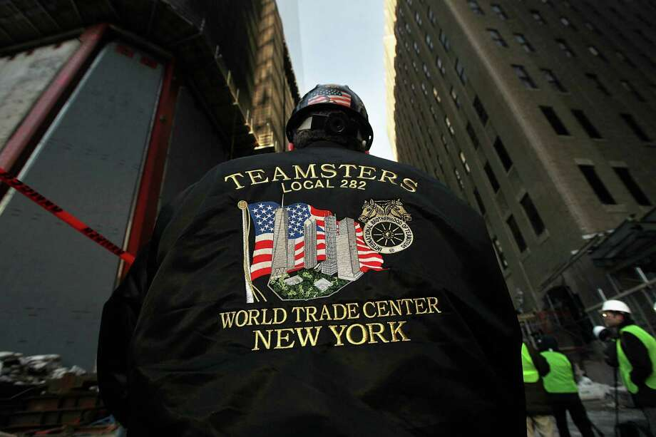 NEW YORK, NY - DECEMBER 12:  A worker wears a Teamsters union jacket as the first piece of the spire is hoisted atop One World Trade Center on December 12, 2012 in New York City.  The first of 18 sections of spire was hoisted atop the 104-story building by crane this morning. Photo: Mario Tama, Getty Images / 2012 Getty Images