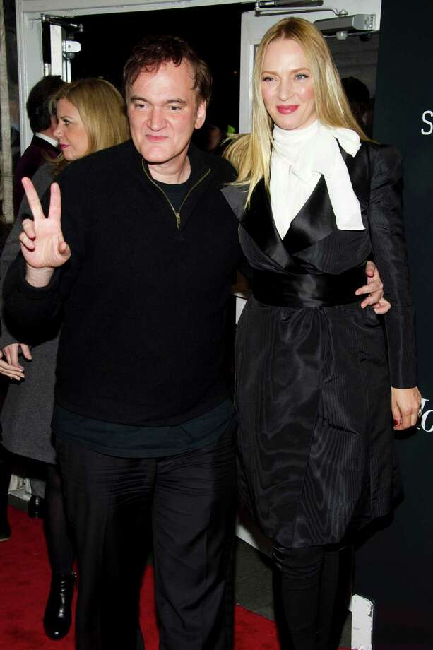 "Quentin Tarantino, left, and Uma Thurman attend the premiere of ""Django Unchained"" on Tuesday, Dec. 11, 2012 in New York. Photo: Charles Sykes, Charles Sykes/Invision/AP / Invision"