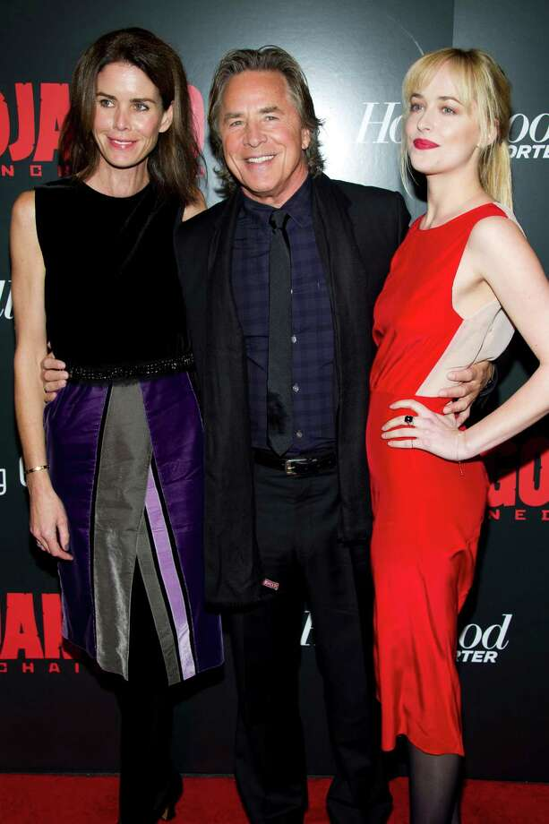 "Don Johnson and his wife Kelley Phleger, left, and daughter Dakota Johnson, right, attend the premiere of ""Django Unchained"" on Tuesday, Dec. 11, 2012 in New York. Photo: Charles Sykes, Charles Sykes/Invision/AP / Invision"