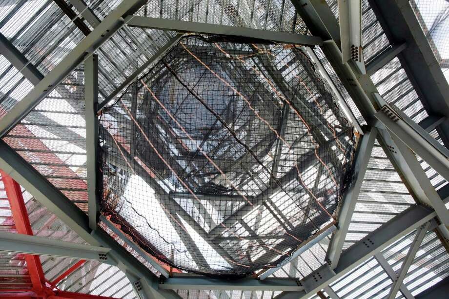 Steel framing outlines the space for a 408-foot spire that will soon arrive onsite at One World Trade Center, Tuesday, Dec. 11, 2012 in New York. The spire is expected to rise into the Manhattan sky by spring. Photo: Mark Lennihan, AP / AP