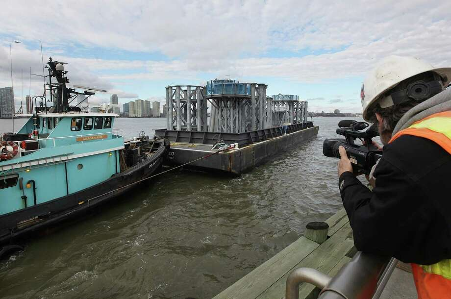 NEW YORK, NY - DECEMBER 11:  Sections of the crowning spire for One World Trade Center arrive on a barge on the Hudson River on December 11, 2012 in New York City. The barge is carrying nine pieces of steel that will eventually  top off One World Trade Center out at a symbolic 1,776 feet, becoming the tallest building in the Western Hemisphere. Photo: Mario Tama, Getty Images / 2012 Getty Images