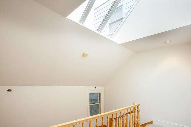 A skylight above the staircase lets in light. Photo: Neil Fraser/Planomatic