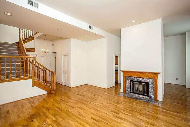 The downstairs lounge has hardwood floors and a fireplace. Photo: Neil Fraser/Planomatic