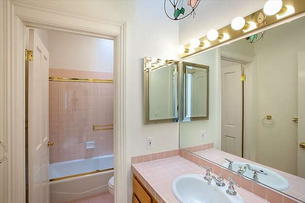 There are 2.5 bathrooms in the three-bedroom condominium.  Photo: Neil Fraser/Planomatic