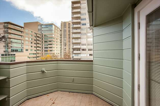 There are decks on the upper and lower levels of the condominium. Photo: Neil Fraser/Planomatic