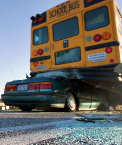Broken glass is seen at  a fatal bus accident in the 23700 block of FM 290 Wednesday, Dec. 12, 2012, in Hockley. Photo: Cody Duty, Houston Chronicle / © 2012 Houston Chronicle