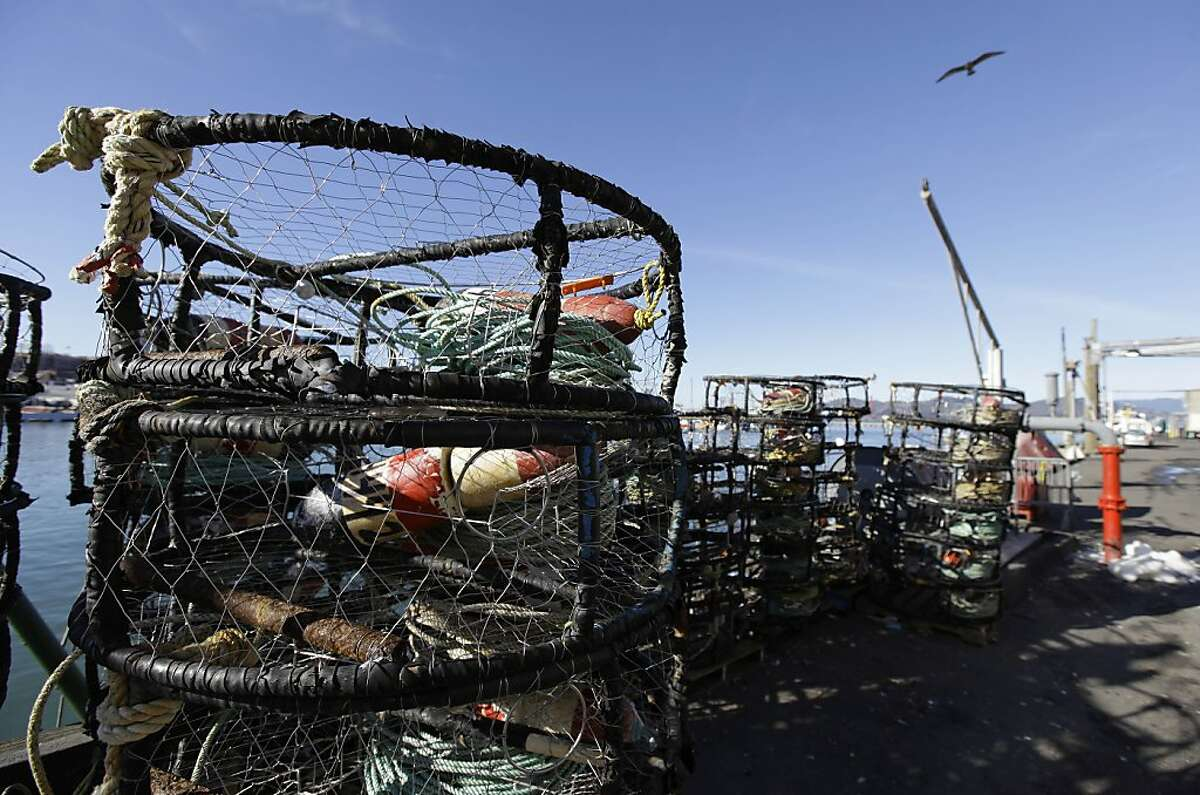 Empty crab pots sit stacked along a pier at Fisherman's Wharf in San Francisco, Monday, Dec. 10, 2012. Dungeness crab boats in the fishing ports of San Francisco, Half Moon Bay and Bodega Bay were idle for several days because of a price dispute.