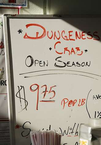 A sign advertises Dungeness crab for sale at nearly $10 a pound at Fisherman's Wharf in San Francisco, Monday, Dec. 10, 2012. Dungeness crab boats in the fishing ports of San Francisco, Half Moon  Bay and Bodega Bay were idle for several days because of a price  dispute. Photo: Eric Risberg, Associated Press