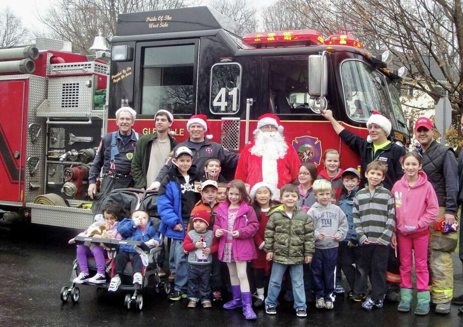"The Glenville Volunteer Fire Company recently held its annual ""Santa Ride."" Here, welcoming the King Merritt Association, are, from left, Sandy Kornberg, David Kravitz, Duke Maloney, ""Santa"" (Joe Sechi), Gino Furano and Frank Napolitano. Photo: Contributed Photo"