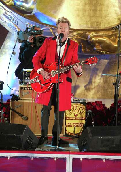 NEW YORK - NOVEMBER 30:  Brian Setzer performs at the lighting of the 73rd annual Rockefeller Center
