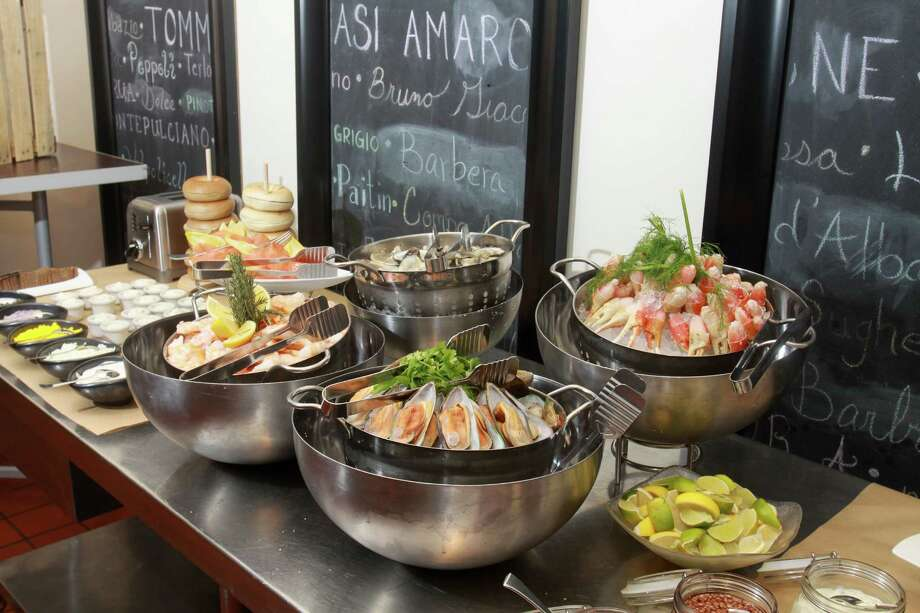 (For the Chronicle/Gary Fountain, November 18, 2012)  The seafood station of the brunch at Quattro, the fine dining room at the Four Seasons Hotel. Photo: Gary Fountain, Freelance / Copyright 2012 Gary Fountain.