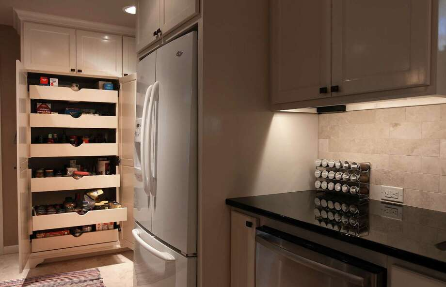Linda and Bill Blanton's newly remodeled kitchen in Pleasanton, Texas on Tuesday, Nov. 27, 2012. A newly added pantry with sliding built-in drawers offer the couple ease of access to ingredients for cooking. Photo: Kin Man Hui, San Antonio Express-News / © 2012 San Antonio Express-News