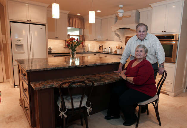 Linda and Bill Blanton's newly remodeled kitchen in Pleasanton, Texas on Tuesday, Nov. 27, 2012. The kitchen was given more room, updated with new cabinetry and drawers and countertops were topped in granite. Both love to cook and the new space gives them all the room they want. Photo: Kin Man Hui, San Antonio Express-News / © 2012 San Antonio Express-News