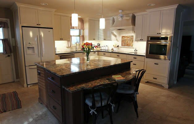 Linda and Bill Blanton's newly remodeled kitchen in Pleasanton, Texas on Tuesday, Nov. 27, 2012. The kitchen was given more room, updated with new cabinetry and drawers and countertops were decked in granite. Both love to cook and the new space gives them all the room they want. Photo: Kin Man Hui, San Antonio Express-News / © 2012 San Antonio Express-News
