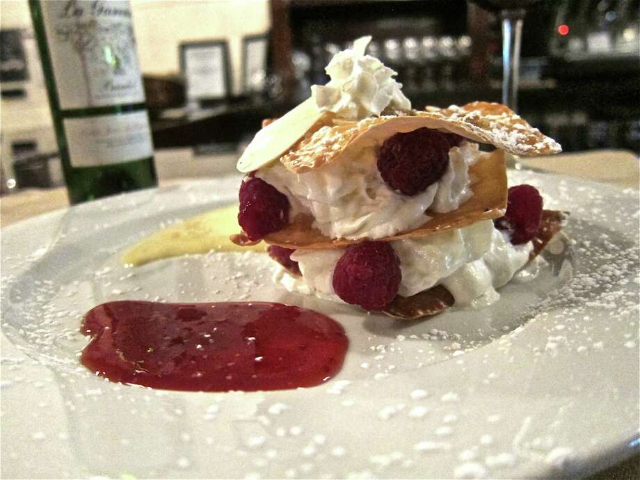 The raspberry millefeuille at Salé-Sucré French Bistro on White Oak was an unexpected pleasure. Photo: Alison Cook