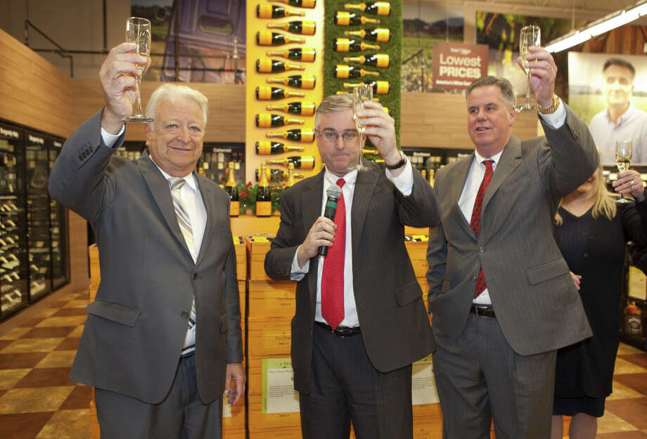 Norwalk Mayor Richard Moccia, Total Wine & More owner David Trone, and president and CEO of the Greater Norwalk Chamber of Commerce, Ed Musante, toast the grand opening of the chain's first store in Connecticut. Photo: Contributed Photo