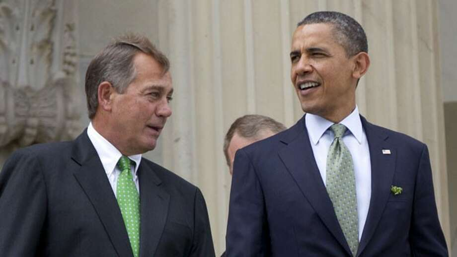 House Speaker John Boehner of Ohio and President Barack Obama walk down the steps of the Capitol in Washington on March 20. (Carolyn Kaster / AP Photo)